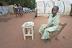Five-year old Rimar Sebit sells peanuts in a camp for more than 12,000 internally displaced persons located on the grounds of the Roman Catholic Cathedral of St. Mary in Wau, South Sudan. Most of the families here were displaced in June, 2016, when armed conflict engulfed Wau.<br /> <br /> Norwegian Church Aid, a member of the ACT Alliance, has provided relief supplies to the displaced in Wau, and has supported the South Sudan Council of Churches as it has struggled to mediate the conflict in Wau.