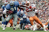 Derrick Moore  carries the ball, Detroit Lions at Tampa Bay Buccaneers NFL football game won by Tampa Bay 24-14 at Tampa Stadium, in Tampa , Florida on Sunday October 2, 1994 . (Photo by Brian Cleary/bcpix.com)
