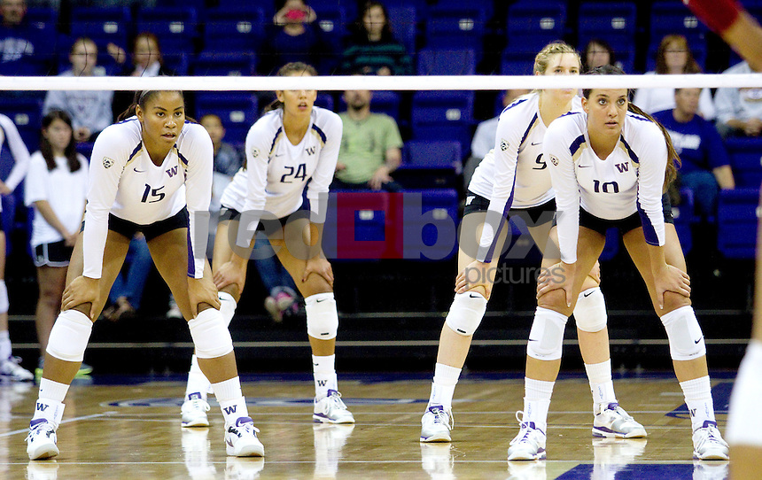 Evan Sanders, Bianca Rowland, Kylin Muñoz, Summer Ross. The University of Washington women's volleyball team plays USC Trojans at Alaska Airlines Arena at the University of Washington in Seattle on Friday September 16, 2011. (Photography By Scott Eklund/Red Box Pictures)