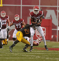 NWA Democrat-Gazette/MICHAEL WOODS • Arkansas receiver Dominique Reed makes a catch in front of Missouri defender Ian Simon in the 1st quarter of Friday's game at Razorback Stadium November 27, 2015.