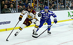 SIOUX FALLS, SD - MARCH 24: Riley Tufte #27 from Minnesota Duluth controls the puck in front of Zack Mirageas #74 from Air Force during their game at the 2018 West Region Men's NCAA DI Hockey Tournament at the Denny Sanford Premier Center in Sioux Falls, SD. (Photo by Dave Eggen/Inertia)