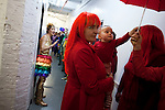 BROOKLYN -- APRIL 16, 2011: Jessi Arrington (L), Tina Roth Eisenberg (C), other Studiomates and friends prepare for their rainbow parade on April 16, 2011 in Dumbo, Brooklyn.   (PHOTOGRAPH BY MICHAEL NAGLE)
