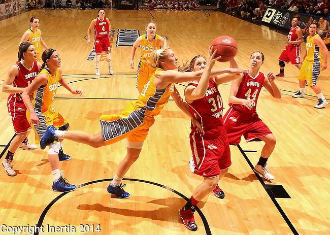 SIOUX FALLS, SD - MARCH 10:  Margaret McCloud #30 from the University of South Dakota is fouled by Mariah Clarin #40 from South Dakota State University in the first half of their semifinal game Monday afternoon at the 2014 Summit League Basketball Tournament in Sioux Falls, SD.  (Photo by Dick Carlson/Inertia)