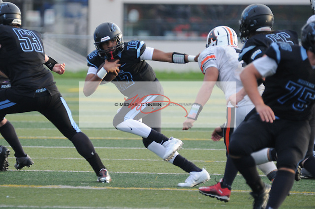 Aaron Tomosulo finds daylignt against West at Chugiak Friday, August 27, 2016.  Photo for the Star by Michael Dinneen