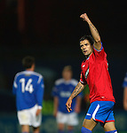 Nacho Novo punches the air to celebrate as he scores goal no 2 for Rangers