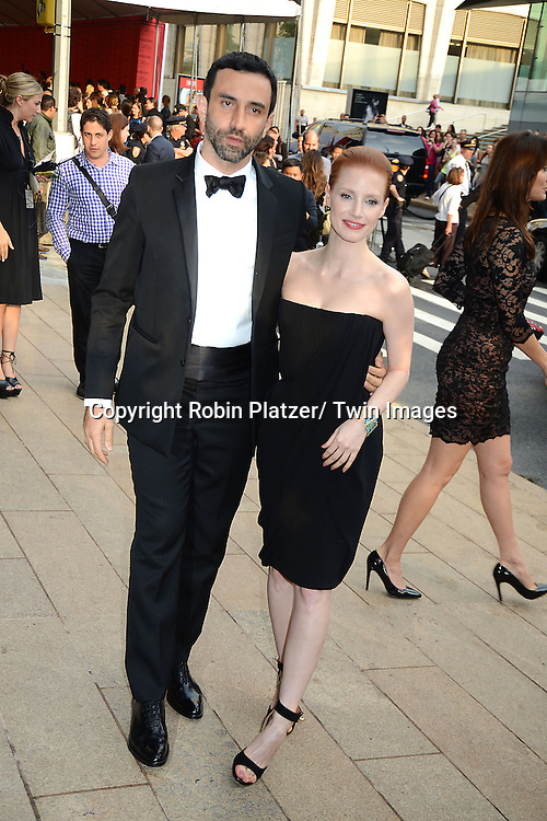 Riccardo Tisci & Jessica Chastain attends The 2013 CFDA Fashion Awards on June 3, 2013 at Alice Tully Hall in New York City.