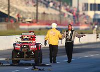 May 18, 2014; Commerce, GA, USA; NHRA top fuel driver Bob Vandergriff yells at members of the Safety Safari about track conditions during the Southern Nationals at Atlanta Dragway. Mandatory Credit: Mark J. Rebilas-USA TODAY Sports