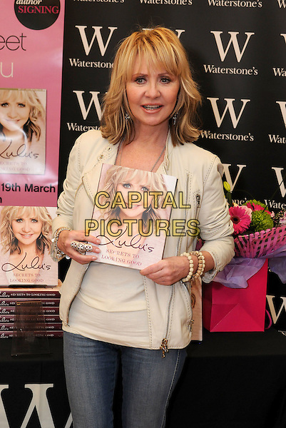 "LULU (Lulu Kennedy Cairns).Signs copies of her new book ""Lulu's Secrets To Looking Good"" at Waterstone's, Bluewater, Greenhithe, Kent, England, UK, 19th March 2010..half length jeans cream jacket top beads bracelets beige leather .CAP/BRC.©Ben Rector/Capital Pictures"