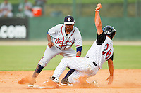 Rome Braves shortstop Elmer Reyes #7 tags out Bill Rice #20 of the Kannapolis Intimidators as he tries to steal second base at CMC-Northeast Stadium on May 28, 2012 in Kannapolis, North Carolina.  The Intimidators defeated the Braves 6-4.  (Brian Westerholt/Four Seam Images)