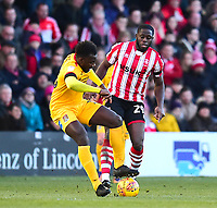 Lincoln City's John Akinde vies for possession with Northampton Town's Aaron Pierre<br /> <br /> Photographer Andrew Vaughan/CameraSport<br /> <br /> The EFL Sky Bet League Two - Lincoln City v Northampton Town - Saturday 9th February 2019 - Sincil Bank - Lincoln<br /> <br /> World Copyright &copy; 2019 CameraSport. All rights reserved. 43 Linden Ave. Countesthorpe. Leicester. England. LE8 5PG - Tel: +44 (0) 116 277 4147 - admin@camerasport.com - www.camerasport.com