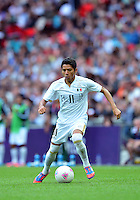 August 07, 2012..Mexico's Javier Aquino in action during Semi Final match at the Wembley Stadium on day eleven in Wembley, England. Mexico defeat Japan 3-1 to reach Men's Finals of the 2012 London Olympics...