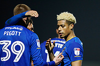 GOAL - High fives all round after Lyle Taylor of AFC Wimbledon scores during the Sky Bet League 1 match between AFC Wimbledon and Charlton Athletic at the Cherry Red Records Stadium, Kingston, England on 10 April 2018. Photo by Carlton Myrie / PRiME Media Images.