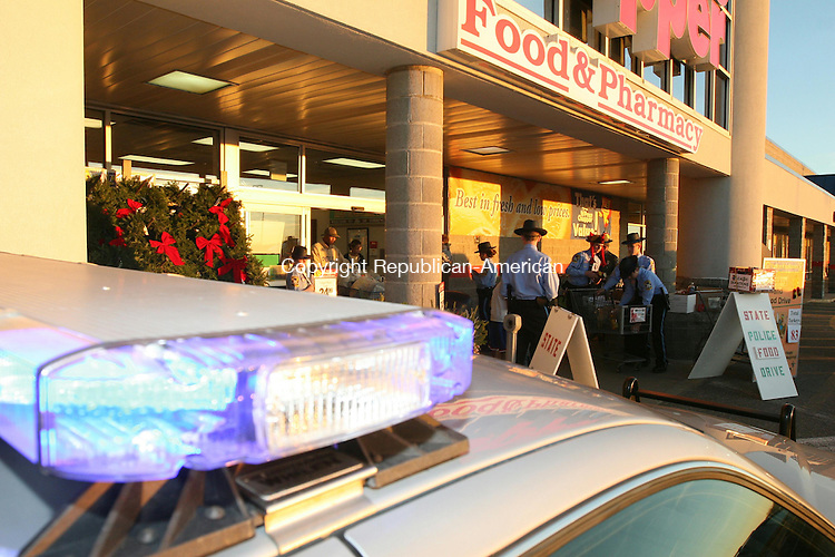 TORRINGTON, CT - 13 November, 2010 - 111310MO03 - Members of State Police Explorer Post 74, led by Sgt. Gregory Kenney, spent 12 hours collecting turkeys and other food outside of Price Chopper Saturday. The donated food, and cash, will be disributed to local food banks, where organizers have long worried about a continued increase in demand amid declining donations. Jim Moore Republican-American.
