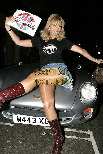 "ANIKA.At Loaded magazine's ""Summer Nudes"" Edition Launch Party at Pangaea Club, Piccadilly, London,.10th August 2004..posing on car funny knee high boots shiny tights.Ref: AH.www.capitalpictures.com.sales@capitalpictures.com.©Capital Pictures."