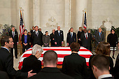 Family of late United States Supreme Court Justice Antonin Scalia take their seats as Supreme Court Justices stand  for a private ceremony in the Great Hall of the US Supreme Court where late Supreme Court Justice Antonin Scalia lies in repose in Washington, DC on Friday, February 19, 2016. From back left are Counselor to the Chief Justice Jeffrey Minear, and Supreme Court Justices Elena Kagan, Samuel Anthony Alito, Jr., Ruth Bader Ginsburg, Anthony M. Kennedy, Chief Justice John G. Roberts, Jr., Clarence Thomas, Stephen G. Breyer, and Sonia Sotomayor.  <br /> Credit: Jacquelyn Martin / Pool via CNP