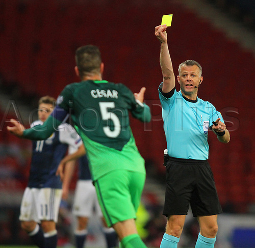 March 26th 2017, Hampden Park, Glasgow, Scotland; World Cup 2018 qualification football, Scotland versus Slovenia;  Bostjan Cesar is booked by referee Bjorn Kuipers