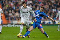Cristiano Ronaldo fights with a Getafe defender