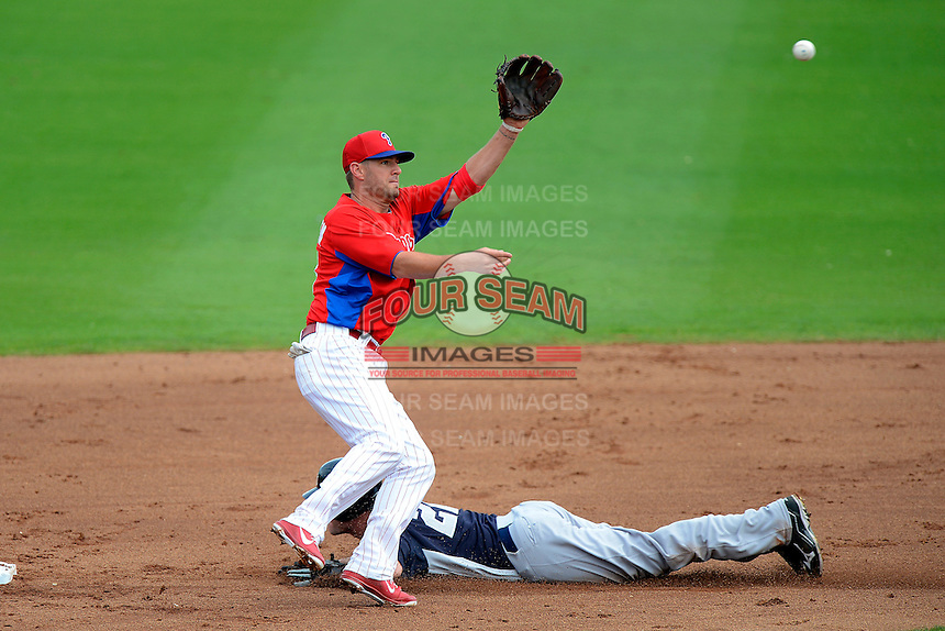 Philadelphia Phillies second baseman Kevin Frandsen #28 takes a throw as Matt Diaz #22 slides in during a Spring Training game against the New York Yankees at Bright House Field on February 26, 2013 in Clearwater, Florida.  Philadelphia defeated New York 4-3.  (Mike Janes/Four Seam Images)