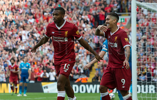 27th August 2017, Anfield, Liverpool, England; EPL Premier League football, Liverpool versus Arsenal; Daniel Sturridge and Roberto Firmino of Liverpool celebrate Sturridge's goal in the 77th minute giving Liverpool a 4-0 lead