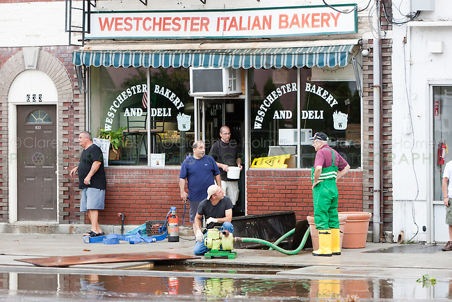 MAMARONECK, NY - AUGUST 28: Mayor Norman Rosenblum of the Village of Mamaroneck, New York talks with residents pumping water out of the basement of a small business on Sunday August 28, 2011 in the aftermath of Hurricane Irene.