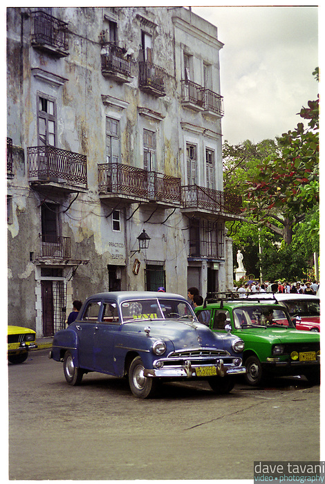 An old style taxi cab sits parked across from the Malecón in Habana Vieja (Old Havana), Cuba, February 18, 1999.