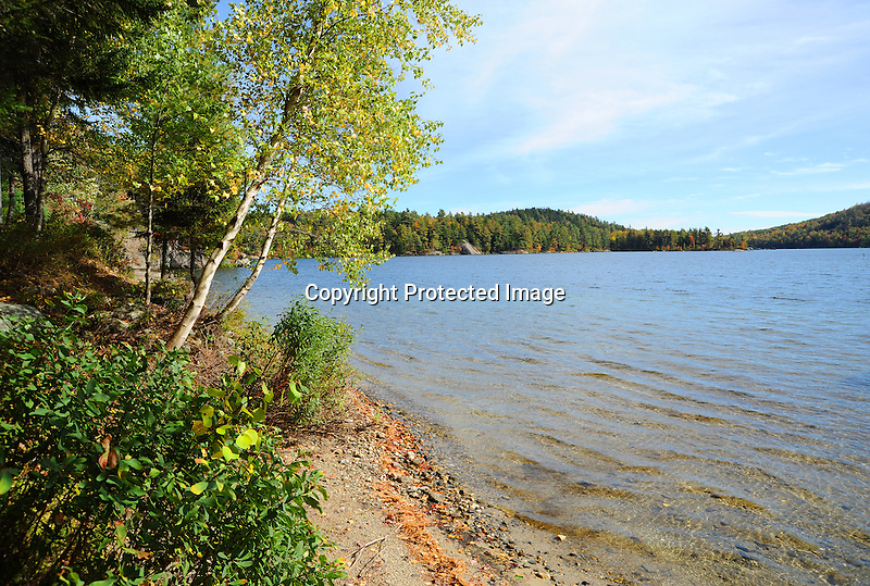 A Quiet Beach on Sand Pond during Fall Season in southern New Hampshire USA