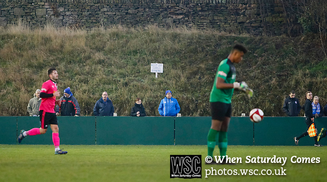 Pickering fans watch as Amissah Jordan bounces the ball. Stocksbridge Park Steels v Pickering Town, Evo-Stik East Division, 17th November 2018. Stocksbridge Park Steels were born from the works team of the local British Steel plant that dominates the town north of Sheffield.<br />