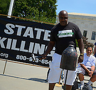 "July 2, 2011 (Washington, DC)  Nathson ""Nate"" Fields, 57, rings a bell at the 18th Annual ""Starvin for Justice '11"" rally to abolish the death penalty.   Nathson spent 11 years on death row  in Illinois before he was found not guilty in 2009.  Thomas J. Mahoney, the trial court judge in Fields' initial trial accepted a $10,000 bribe to influence his decision in the case and was later indicted.  July 2, 2011, marks the 35th anniversary of the 1976 Gregg v. Georgia decision, which allowed executions in the United States to resume.  (Photo: Don Baxter/Media Images International)"