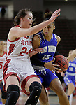 VERMILLION, SD: JANUARY 13:  De'Jour Young #13 of Ft. Wayne drives on Ciara Duffy #24 of South Dakota during their Summit League game Saturday January 13 at the Sanford Coyote Sports Center in Vermillion, S.D.   (Photo by Dick Carlson/Inertia)