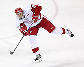 Jamie McBain 2 of the University of Wisconsin fires the puck. The Boston College Eagles defeated the University of Wisconsin Badgers 3-0 on Friday, October 27, 2006, at the Kohl Center in Madison, Wisconsin in their first meeting since the 2006 Frozen Four Final which Wisconsin won 2-1 to take the national championship.<br />