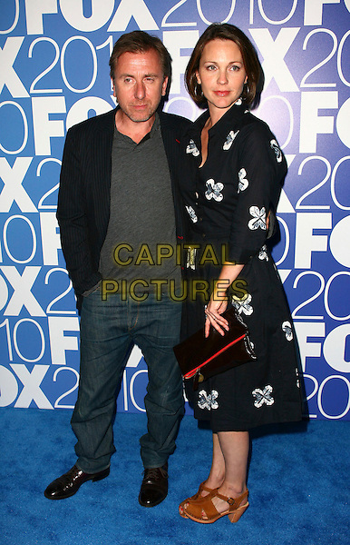 TIM ROTH & KELLI WILLIAMS.The 2010 FOX Upfront after party at Wollman Rink, Central Park, New York City, NY, USA..May 17th, 2010.full length black suit  grey gray jacket top dress white floral print brown shoes jeans denim.CAP/ADM/PZ.©Paul Zimmerman/AdMedia/Capital Pictures.