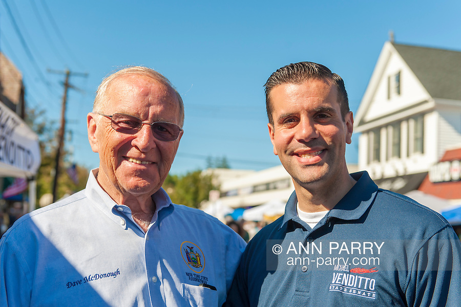 Bellmore, New York, USA. 20th September 2015. L-R, New York State Assemblyman DAVE MCDONOUGH and New York State Senator MICHAEL VENDITTO, both Republicans, attend the 29th Annual Bellmore Family Street Festival, with over 100,000 people expected to attend over the weekend.