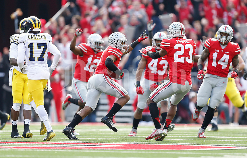 Ohio State Buckeyes defensive back Vonn Bell (11) celebrates an interception during the college football game between the Ohio State Buckeyes and the Michigan Wolverines at Ohio Stadium in Columbus, Saturday morning, November 29, 2014. The Ohio State Buckeyes defeated the Michigan Wolverines 42 - 28. (The Columbus Dispatch / Eamon Queeney)