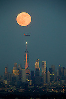 EAGLE ROCK, NJ - JUNE 09: The Strawberry Moon rises over lower Manhattan and One World Trade Center on June 06, 2017 in Montclair, New Jersey. Photo by VIEWpress/Eduardo MunozAlvarez
