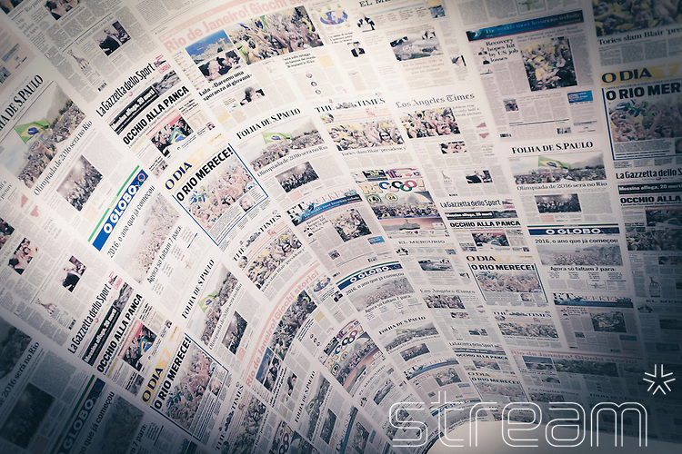 A collage of newspaper articles from Brazilian and International newspapers reporting Brazil's bid win to host the 2016 Olympic games. Part of the Casa Brazil exhibition at Somerset House, London, 2012
