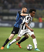 Calcio, Serie A: Inter - Juventus, Milano, stadio Giuseppe Meazza (San Siro), 28 aprile 2018.<br /> Juventus' Juan Cuadrado (r) in action with Inter's Marcelo Brozovic (l) during the Italian Serie A football match between Inter Milan and Juventus at Giuseppe Meazza (San Siro) stadium, April 28, 2018.<br /> UPDATE IMAGES PRESS/Isabella Bonotto