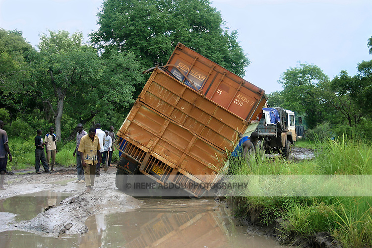 A container truck from Uganda heads towards Rumbek, South Sudan with supplies, but gets stuck in the mud between Yei and Mundri.