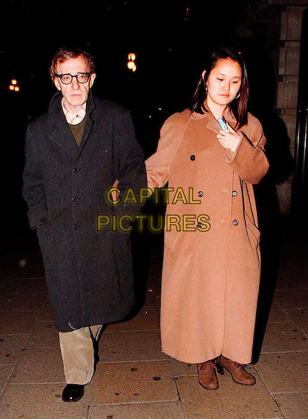 WOODY ALLEN & SOON-YI..At the Criterion Brasserie after performing at the Royal Festival Hall..full length, full-length, black coat, brown coat, adopted, daughter, father, affair..www.capitalpictures.com..sales@capitalpictures.com..©Capital Pictures