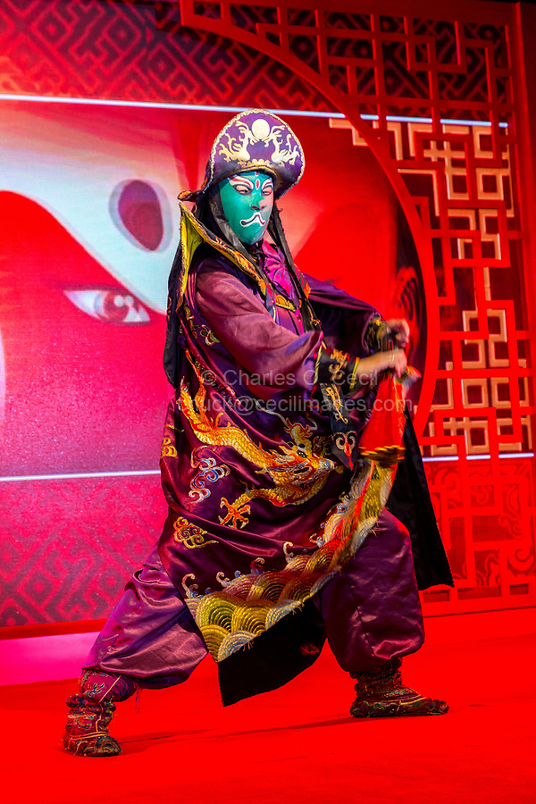 Wenzhou, Zhejiang, China.  Chinese Opera Performer and Face Changing Demonstration.