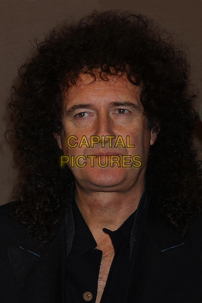 BRIAN MAY  .46664 Press Conference To Announce The Details Of A New Charity Initiative To Combat AIDS And HIV Issues Around The World. The Hilton, London, UK.21st October 2003 .headshot, portrait.www.capitalpictures.com.sales@capitalpictures.com.Supplied By Capital PIctures