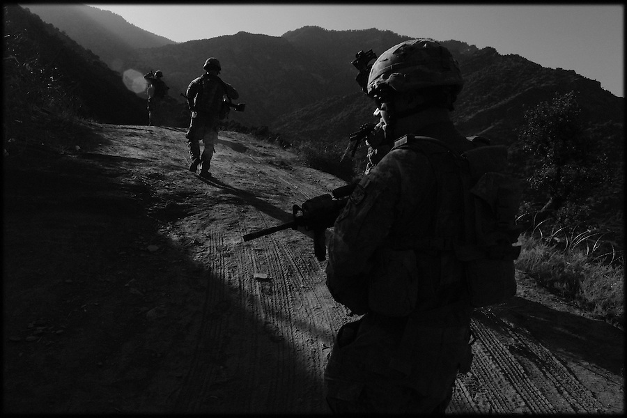 Soldiers from Baker Co. 2-12 Infantry Regiment 4th Brigade 4th Infantry Division patrol the slopes of Afghanistan's Korengal Valley in the summer of 2009.