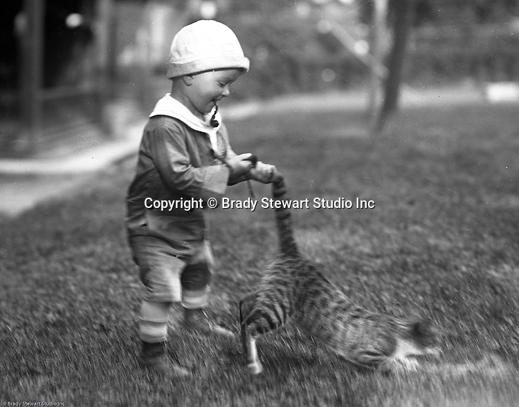 Wilkinsburg PA:  Brady Stewart Jr playing with the neighbor's cat - 1922