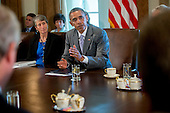 United States President Barack Obama speaks during a cabinet meeting at the White House with Sally Jewell, U.S. secretary of the interior secretary, left, in Washington, D.C., U.S., on Tuesday, July 1, 2014. Obama said yesterday he'll go it alone on changing U.S. immigration rules because House Republicans won't act. <br /> Credit: Andrew Harrer / Pool via CNP