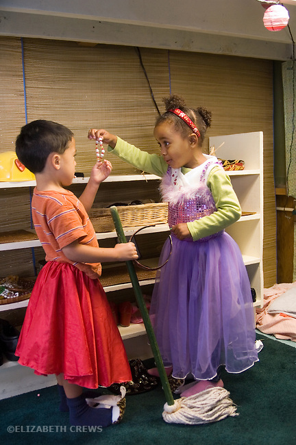 Berkeley CA Preschoolers, four-years-old, dressing up in fancy skirts for imaginative play