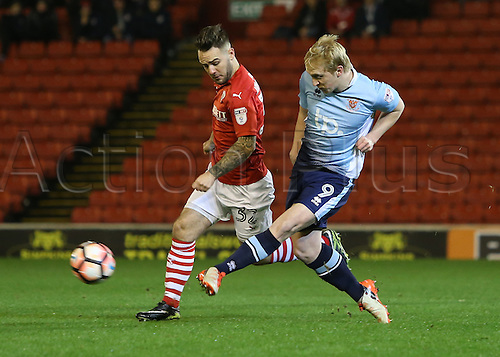 17th January 2017, Oakwell, Barnsley, South Yorkshire, England; FA Cup 3rd round replay, Barnsley versus Blackpool; Blackpool's Mark Cullan clears the ball under pressure from Barnsley's Adam Armstrong
