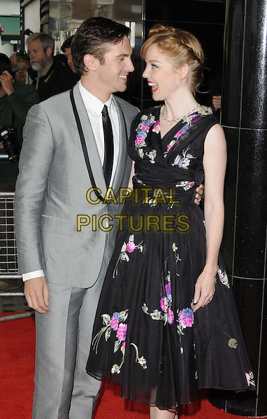 Dan Stevens &amp; Susie Hariet<br /> The &quot;Summer In February&quot; VIP gala film screening, Curzon Mayfair cinema, Curzon St., London, England.<br /> June 10th, 2013<br /> half 3/4 profile mouth open length white shirt black tie grey gray suit black pink floral print dress married husband wife <br /> CAP/CAN<br /> &copy;Can Nguyen/Capital Pictures