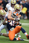 Boston College Eagles defensive lineman Brian Mihalik (99) tackles Syracuse Orange running back Jerome Smith (45) during a game at the Carrier Dome on November 30, 2013 in Syracuse, New York.  Syracuse defeated Boston College 34-31.  (Copyright Mike Janes Photography)