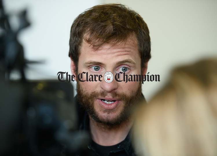 John Burke is interviewed by the media on his arrival back to Shannon Airport, following his successful attempt, being the first Clare person ever to climb Mount Everest. Photograph by John Kelly.