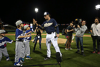 PEORIA, AZ - MARCH 12:  Actor Will Ferrell of the San Diego Padres  talks to the fans after playing right field against the Los Angeles Dodgers during a spring training game at the Peoria Sports Complex on March 12, 2015 in Peoria, Arizona. Ferrell played nine positions for ten teams in five games in one day to raise money for cancer. (Photo by Brad Mangin)