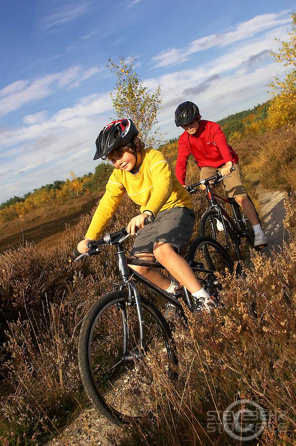 Sam and Josh Behr riding Islabikes Benin bikes..Wentworth , Surrey     October 2007..pic copyright Steve Behr / Stockfile